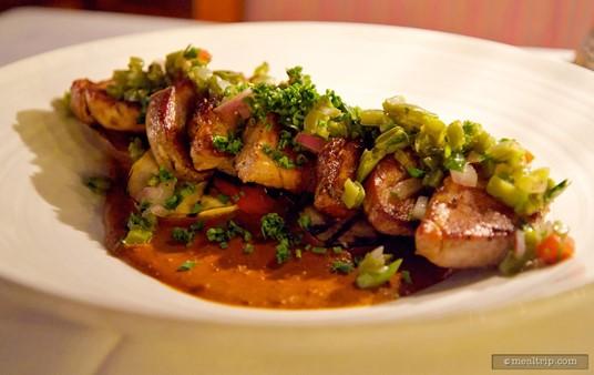 Lomo de Puerco en Pipian - Pork tenderloin served over roasted vegetables.