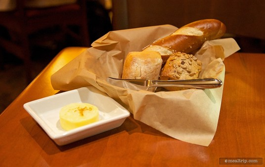 Le Cellier bread service, including sourdough, multi-grain, and pretzel bread, served with butter dashed with maple sugar.