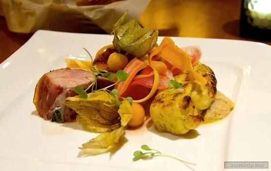 """Snake River Farms"" Pork Tenderloin wrapped in Prosciutto, Duchess  Potato, Truffle Tremor-Garlic Puree, Gooseberry, and Smoked Pepperdew  Relish."