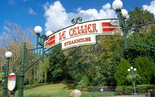 The Le Cellier sign on this iron lamp overhang is at the beginning of the walkway leading to the restaurant.