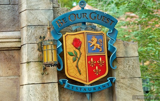 Be Our Guest sign at the foot of the bridge way to the restaurant.