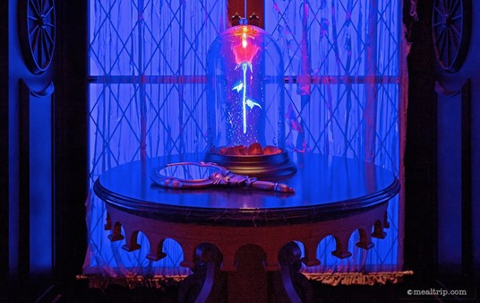 """The enchanted rose, in the Magic Kingdom's Be Our Guest restaurant. The rose is located in the """"West Wing"""" dining area."""