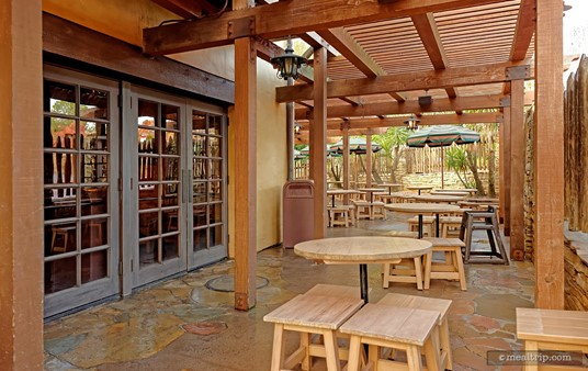 There is some outdoor seating at Pecos Bill's that provides a bit of protection from the sun but not the rain. The roof is made up of wood slats.