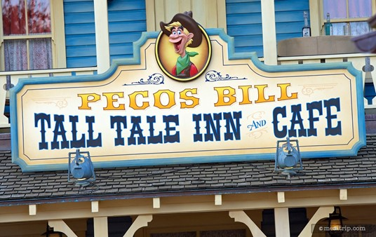 Sign above the front entrance to Pecos Bill Tall Tale Inn and Cafe.