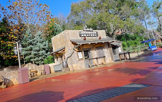 There's a small uncovered seating area to the left of the Golden Oak Outpost kiosk.