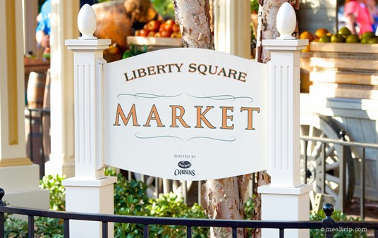 Liberty Square Market sign, which is located just behind a seating bench, so it's not always easy to see.