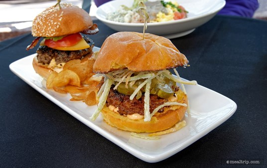Derby Sliders, the front-most slider in this photo, is the house-made  chorizo with chipotle mayo slider, with manchego cheese, pickles, and  crispy onions.