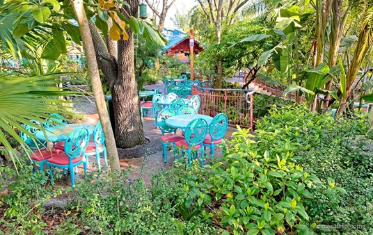 Some of the tables at Flame Tree BBQ are covered only by the tree canopy  overhead, which provides cover from the sun, but not so much from the  rain.