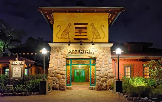 The main entrance to Pizzafari at night.