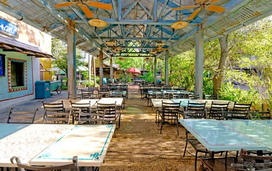 The Anandapur Local Food Cafes' main dining area to the west of the  order and food pickup area. To the left of the image, there's a small  drink window, that offers soda, water, and specialty beers and  cocktails.