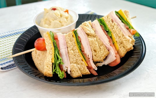 """Mango Joe's """"Turkey & Ham Stack Sandwich"""" combines wheat bread with turkey, ham, cheese, lettuce and tomato. The """"side item"""" for this one is potato salad."""