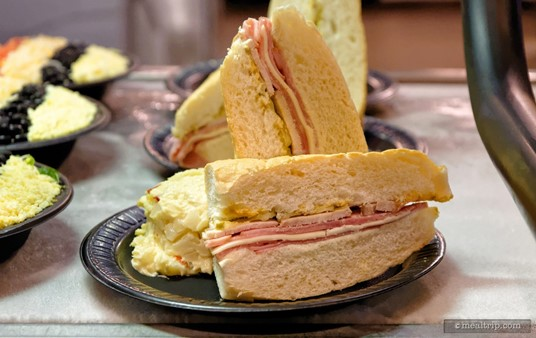 """The Seafire Cuban Sandwich is served cold and contains Ham, Pork, Swiss Cheese, Pickles, Mayonnaise and Mustard. It's plated with Potato Salad. The sandwich is one of the few items at Seafire Grill that is not on the """"All Day Dining Deal"""" program."""