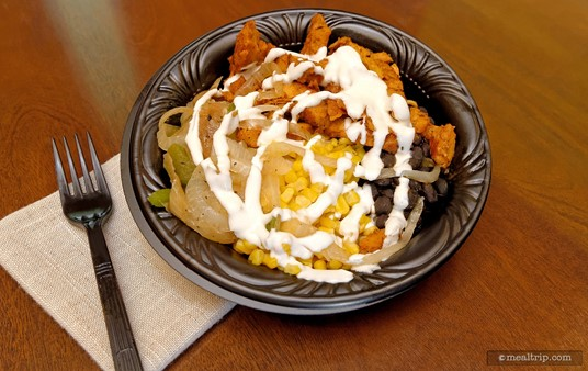 In early 2015 SeaWorld Orlando's Seafire Inn switched to a Tex-Mex style of cuisine. Pictured here is the Tex-Mex Rice Bowl entrée, which is basically Fajita fixings, without the Fajita. The bowl is made to order, so if you're not a fan of the sour cream, you can ask for it to be left off.