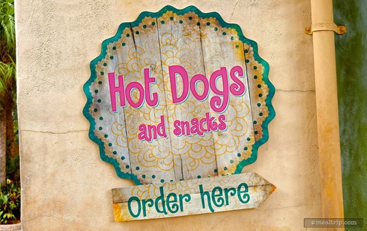"""The side sign for the Funnel Cakery has been changed back to read """"Hot Dogs and Snacks"""", but may change seasonally? As far as we know, the official name of the location is Hot Dog and Snacks. (Photo and caption from Spring 2017.)"""