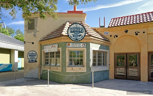 The Voyager's Snacks kiosk/window is located just to the left of the Voyager's Smokehouse main entrance.