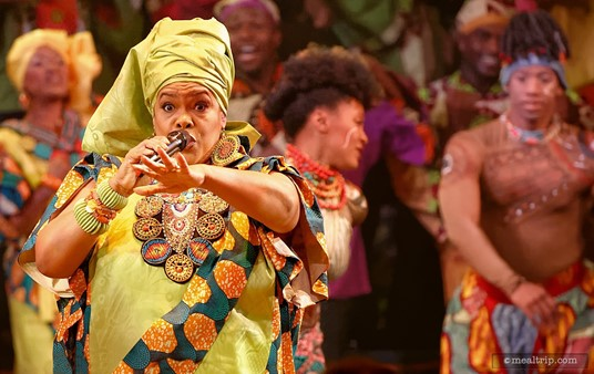 """A soloist steps out of the choir during """"The Lion King, Concert in the Wild"""" performance at Harambe Nights."""