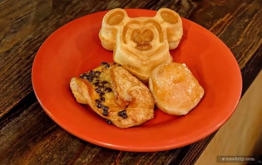 A Mickey Waffle with Maple Syrup, Chocolate Twists and a glazed Doughnut Hole.