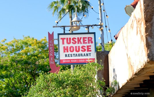The Check In sign over the entrance to Tusker House.