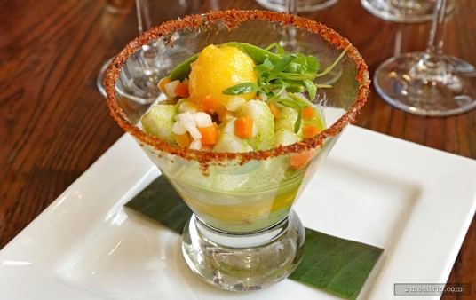 Combining scallops, onions, cilantro, avocado and lime juice, the Mayan Ceviche was  served in a salt rimmed, margarita glass with a tiny scoop of mango  sorbe.