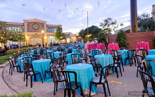 """The tables are set up and ready for guests in the """"teardrop"""" area at the end of the Avenue of the Americas."""