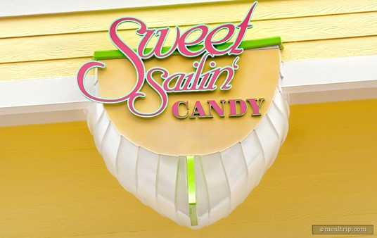 The boat bottom shaped Sweet Sailin' Candy sign that hangs over the front of the shop. (Circa 2015)