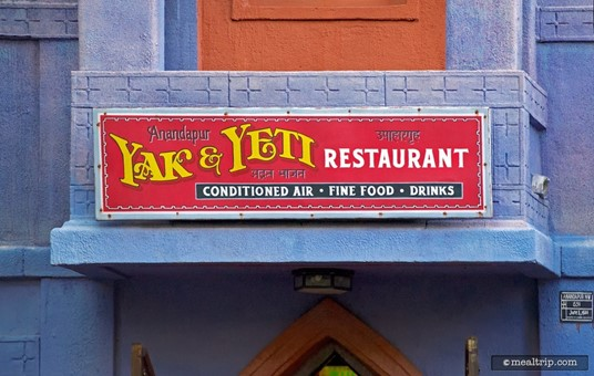 Sign above the entrance to the Yak & Yeti Restaurant.