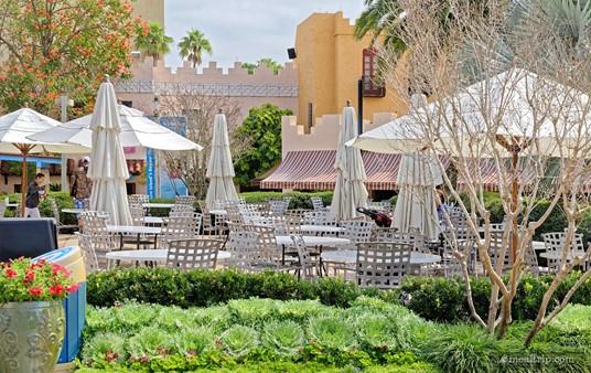 The Moroccan themed building facades give the outdoor seating area an open-bazaar feel.