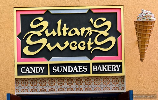 There are several Sultan's Sweets signs around the building. This one features a giant ice cream cone on one side.