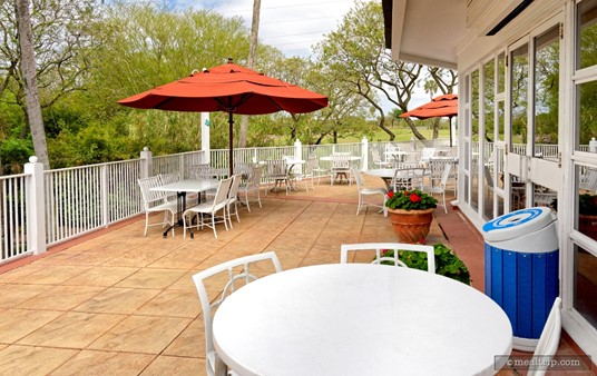 A few of the outdoor patio tables are covered with umbrellas, while others are close enough to the building and overhang, that they are in the shade as well.