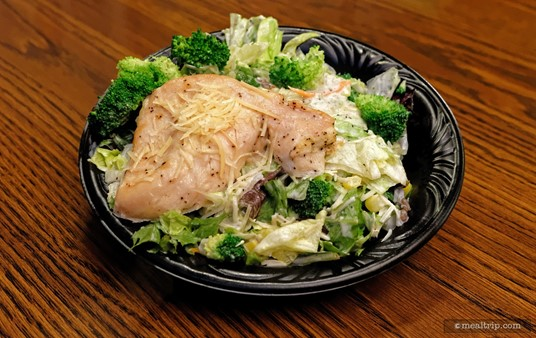 The Broccoli Peppercorn Salad features Fresh Mixed Greens topped with Grilled Chicken, Garden Vegetables,  Broccoli, Sunflower Seeds, and Parmesan Cheese and is tossed with a Peppercorn  Dressing.