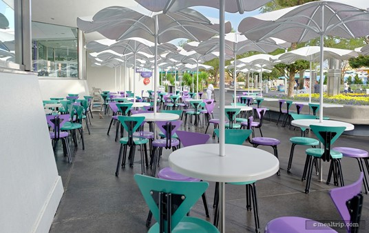 There is a fair amount of additional outdoor seating at Cosmic Ray's. Pictured here is the outdoor seating across from the Tomorrowland Speedway, which is in the shade of the building, until about noon.