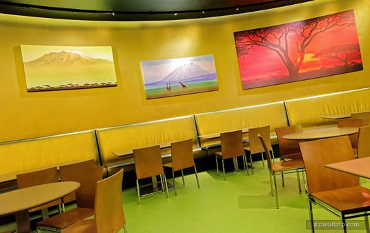 The Landscape of Flavors seating areas have different themed artwork on the walls. This is the Lion King room.