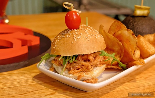 A barbecue pulled chicken slider with arugula and house-made chips is the second slider in the Slider Sampler from the Rebel Hangar.