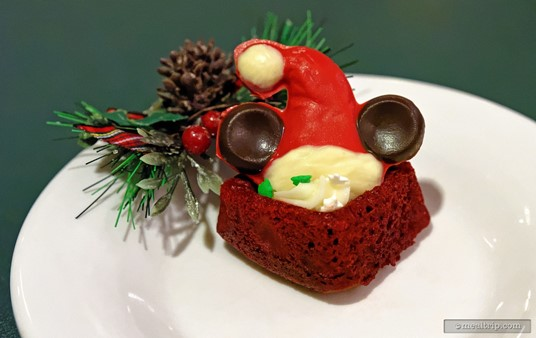 The Mickey Santa Hat Topped Red Velvet Cake was moist and yummy.