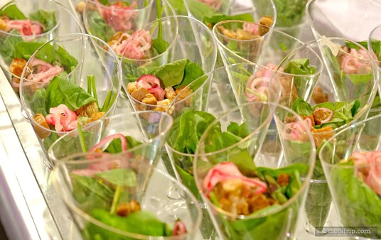 """Leaf Spinach Salad Cones with Quick Pickled Onions, Pork Belly Croutons and Brown Sugar Vinaigrette from the Dining Through the Decades' 1925-1936 """"Family and a Mouse - Sunday Dinner Station""""."""