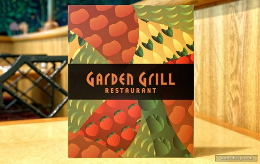 """Even though there's no """"menu"""" per say (Garden Grill is family-style platters), there's still a square """"program"""" of sorts... to let you know what food is going to be on the platter. There are also some """"adult"""" beverage options listed inside."""