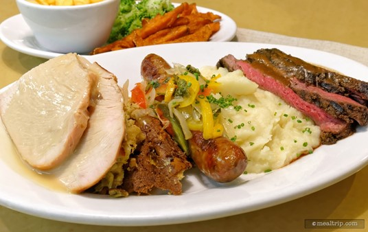 In the middle of the main Garden Grill lunch platter is an Italian Sausage with Sauteed Peppers and Onions.