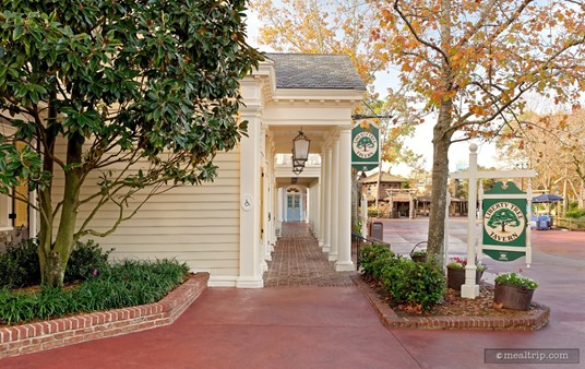 The Liberty Tree Tavern has a covered walkway in front of the building itself. However, it's quite often used as stroller parking. This early morning shot was taken in the fall of the year, and features two of the Liberty Tree Tavern signs.