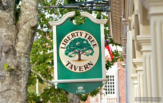 Street sign hanging in front of Liberty Tree Tavern.