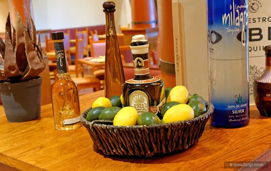 Pictured here, a bottle of 1921 Casa Tequila Cream is placed in a basket (although, from a flavor standpoint, I'm not sure I would pair this one with lemons and limes).