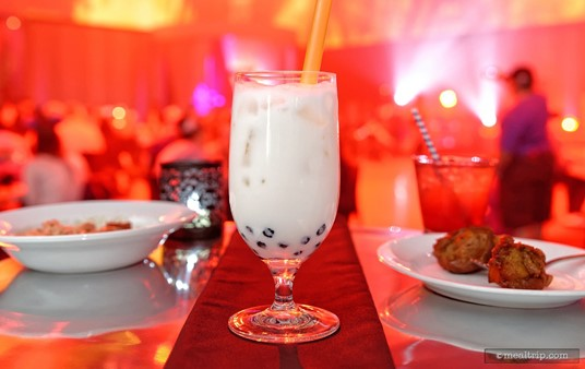 """Cruella De Vil's cocktail of choice is the """"Devious Dalmatian"""" which combines Godiva® White Chocolate Liqueur, Milk, and Coconut Milk, Garnished with Boba Pearls."""