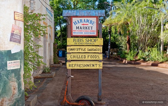 You can tell it's a hot day at the Harambe Market because someone's scooter is half melting into the sidewalk!