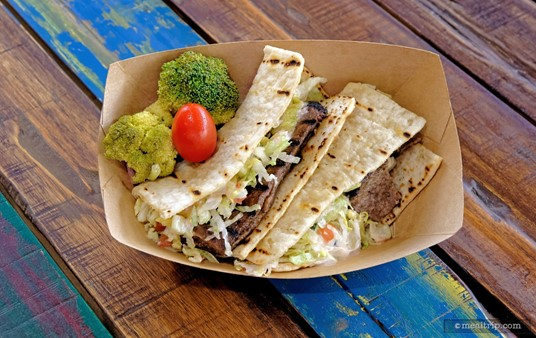 """Here the Harambe Market's All-Beef Gyro Flatbread (from the """"Kitamu"""" window) is served with pickled Roasted Broccoli  and Tomato Salad (the side dish changes seasonally)."""