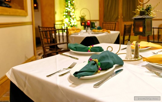 A close up of the place settings at Scat Cat's Cafe for the holidays.