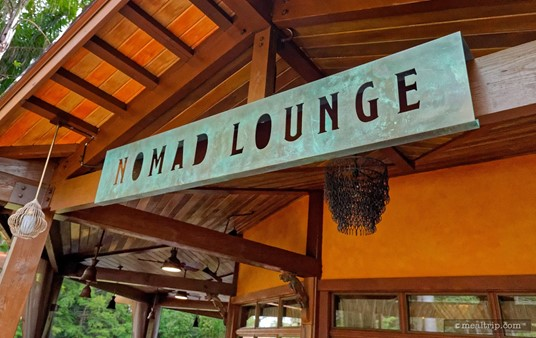 The main entrance sign at Nomad Lounge.