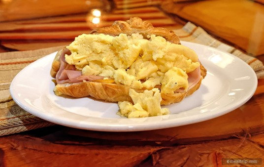 """The """"Sunrise Sandwich"""" from Sanaa's Breakfast menu is made with one farm-fresh egg, ham, cheddar cheese, and is served on a croissant."""