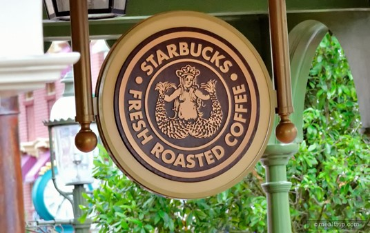 There's an easy to miss, small, round Starbucks logo hanging over the door of the Main Street Bakery.