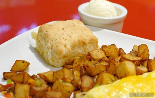 """The House-made Buttermilk Cheddar Biscuit is served with a couple of the breakfast plates at the Whispering Canyon Cafe. It is surprisingly light. The whipped """"butter"""" in the background, was really more like margarine."""