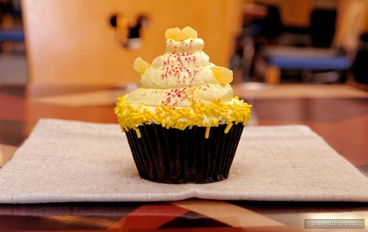 It's a Pineapple Cupcake with Pineapple Filling Raspberry Buttercream! The Contempo Cafe always has a couple different flavors of premium cupcakes on the menu. (The flavors change seasonally.)