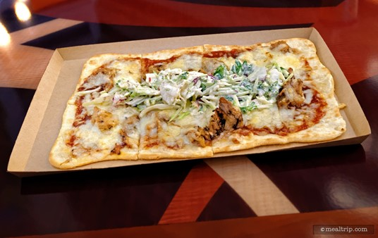 """The rectangle shaped """"flatbreads"""" at Disney are better than the round """"pizzas"""". While they are a few dollars more, it's worth the upgrade. Pictured here is a Smoked Pulled Pork Flatbread with Barbecue Sauce, Jack Cheese, and Vegetable-style Coleslaw."""